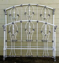 Although made in the Victorian era. This bed has definite Art Deco styling. A unique white crackle and silver finish for a NYC client.