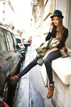 Black jeans, black t-shirt, fur vest, black fedora, brown boots