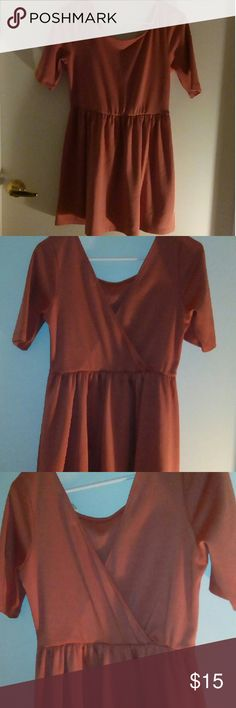 Forever21 Rustic Orange Dress The color is about a rustic orange like color. The second and third picture are back of dress. Forever 21 Dresses