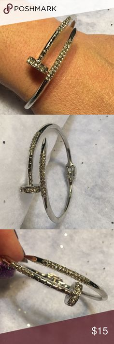 O1-3 Silver Nail Bracelet Such a fun piece. Silver toned with lots of little rhinestones. Metal has some imperfections but I still love these. New in package. Jewelry Bracelets