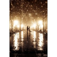 Couple going to kissing at alley in night lights. ❤ liked on Polyvore