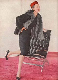 September Vogue 1959 One of the new excitements of the American collections: wonderfully tailored black suit with an upsurge of silver fox collar and lining. Suit of nubbly wool and natural Canadian silver fox, by Dan Millstein.