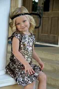 Flower girl in a glitter.  I'd do glitter top with matching tulle skirt