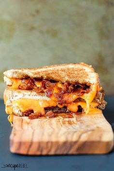 Toasty bread, melty cheese and sweet and smoky maple bacon jam make this the best grilled cheese you'll ever have! www.thereciperebel.com