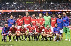 Manchester United's Legends squad pose at the Friends Arena in Stockholm on Thursday...