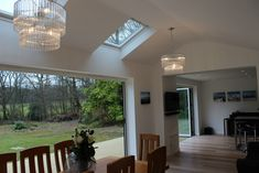 Removed old conservatory and re built a new extension. To create large open plan kitchen and dining area. 2 x Sets of bi-fold doors onto decked area with skylights and vaulted ceiling. We imported the handleless kitchen from Germany.