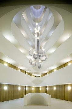 This stunning contemporary chandelier lighting installation design features…