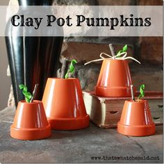 Clay Pot Pumpkins.  Perfect for your mantle or centerpiece for your table with thatswhatchesaid.net #fall #pumpkins #decor