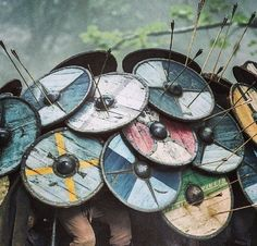 """Shield wall was a """"wall of shields"""" formed by warriors standing in formation shoulder to shoulder, holding their shields so that they abut or overlap. Each man benefits from the protection of his neighbour's shield, usually the man to his right, as well as his own. Often, soldiers would use their weapons to support each other by stabbing and slashing to the left or the right, rather than just ahead."""