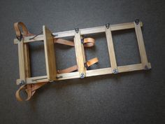 This frame pack is a hardwood, leather, and forged iron fully functional recreation of historical frame packs. A shelf assists with the heavier