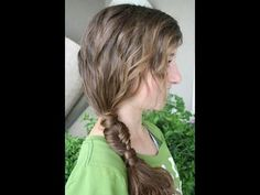 Side pony wrapped, fishtail braid, wrapped pony again.  Shown on a video, looks really easy.