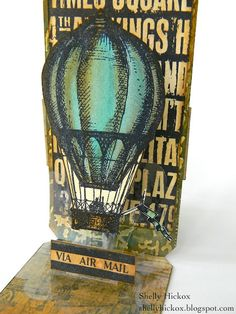 @Shelly Hickox shares a tutorial on our blog for combining the @Tim Holtz Tag and Bookplate die with @Karen Burniston 's Scallop Circle Pop Up die to create an incredible pop up tag.
