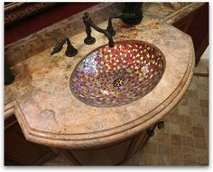 unusual mosaic sink design - i would use different colors - but this is a great idea!