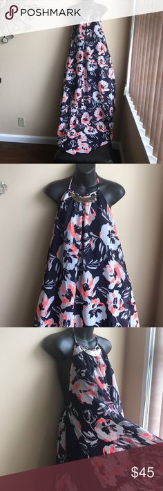 1 hr sale Plus sz 2X asymmetrical Hem Halter dress Brand new asymmetrical Hem Halter dress with tie up at neck on the back . Dress is lined . Outside dress is Floral print with side slits on both sides starting from high up . Gorgeous pierce which will flow as u walk . Polyester. No tags Dresses Asymmetrical