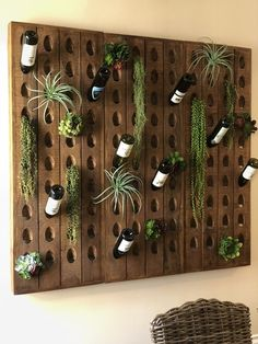 Gardening made easy. Go vertical with a wall of faux succulents that are maintenancefree and look just like the real thing. Wine Rack Storage, Wine Rack Wall, Wine Racks, Wine Bottle Holders, Wine Bottle Crafts, Wine Bottle Display, Wine Bottle Wall, Riddling Rack, Wine Wall Decor