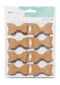 Eight (8) cork bows measuring approximately 2.25 x 1.25 inches each.