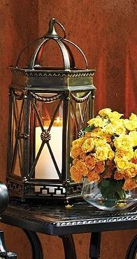 Outdoor lighting gains a refined accent when candles gleam through this gorgeously detailed Avalon Lantern.