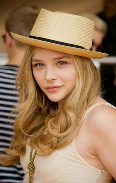 With her gorgeous face, golden hair, sexy shoulders and sweet tits, the Panama hat is like cute Chloe overkill!