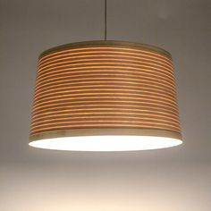 This uncomplicated wooden drum lampshade is made from coiled steam bent ash, oak or walnut wood and is available in a standard or large size.Sustainably sourced ash, oak or walnut.Inspired by the clinker boats made using traditional steam bending methods here in Cornwall. Tom designed this light to be simple and honest, and a testament to the beauty of the natural materials and methods used to craft the wooden lampshade. Perfectly suited to hang on in its own in say a bedroom, living room…