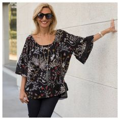 Its all about cool sleeve treatments right now and our Black Print Blouse with Ruffle Sleeves and Lace Trim sure has that feature.  Available in our shop, stop by and check it out!  www.jacketsociety.com