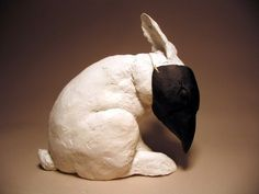 White Rabbit with mask sculpture