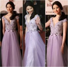 "June 14, 2014  Chinese actress Crystal Liu was breathtaking in GEORGES HOBEIKA for the 17th Shanghai Film Festival premiere of ""Out Cast."" Liu stole the red carpet in a gorgeous lavender, crepe and tulle princess-cut gown with a deep-V bust embroidered in pearls, crystals and guipure lace with a bow tie belt from Georges Hobeika SS 2014 Couture collection."