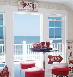 A small table and beach signs / retro stools - all perfect for a beach caravan