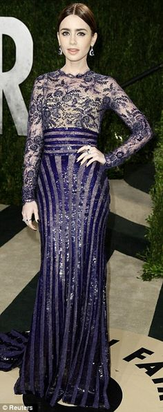 Lily Collins got it right in stunning black and sapphire sequins at the Vanity Fair Oscars party on Sunday night