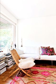Bright living room with pink pillows