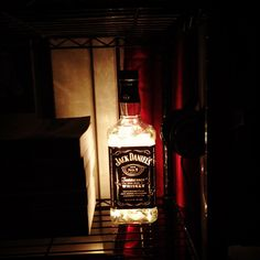 Made myself a new lamp. Upcycled Jack Daniels bottle from the recycling plant. Drilled a hole with a half inch class cutting bit and dremel tool with a glass grinding bit. Used a string of 50 white Christmas lights.