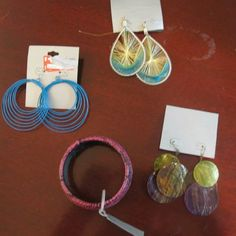NWT Jewelry Lot Set Of 4 One pink bracelet with faux snake-skin design, one pair of blue dangling hoop earrings, one pair of dangling feathered earrings, one pair of dangling brown and green coins. Charlotte Russe Jewelry Earrings