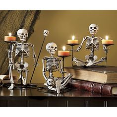 Set of 3 Skeleton Candle holders...This gives me an idea for my tiny dollar store skeletons.