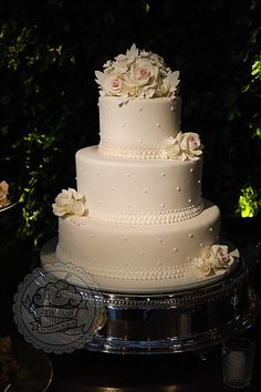 White sugar flowers wedding cake
