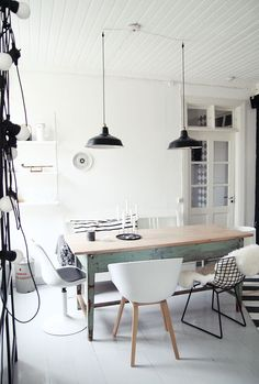 ☆ hanging lights draped down cupboard dining table in kitchen mismatched chairs white walls and flooring