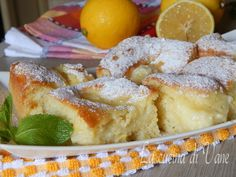 quadrotti cremosi al limone - Creamy Lemon Squares (use butter instead of oil?)