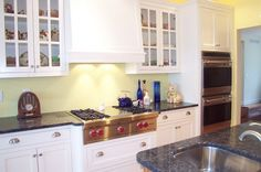 Traditional Kitchen Design with White Kitchen Cabinets and Soft Yellow Wall Color Paints