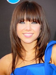Long straight light brown with face framing layers and bangs hairst