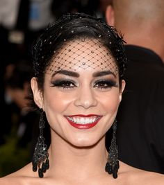 Vanessa went all-out rocking a red lip and smoky eyes (with a lotta lash) and a hairnet with barbed wire trimming.   - Cosmopolitan.co.uk