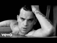 Robbie Williams - feel -primer sencillo de su quinto álbum de estudio, Escapology, en 2002.