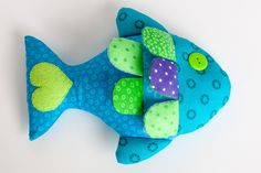 Fish Bean Bag Toy- easy tutorial and so cute! I added bags inside the fins for crinkle and beans to the body.