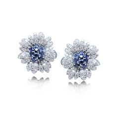 A PAIR OF PLATINUM, SAPPHIRE AND DIAMOND EARRINGS, BY VAN CLEEF & ARPELS, CIRCA 1950S