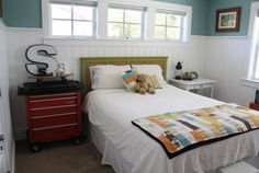 Home Sweet Home on a Budget:  Bedrooms for Boys  love the toolbox bedside table...I've always wanted to incorporate a toolbox into my kitchen, just love how easy the drawers slide!! (weird, I know)