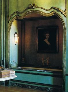 Axel and May Vervoordt's bathroom.   18th century boiserie, Thomas Gainsborough painting, Crystal chandelier, Champagne?