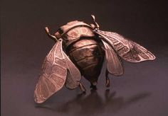 Cicada Brooch. Moving head, thorax, front wings, and hind wings.  COOL!