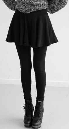 combat boots, black leggings, skirt and sweater