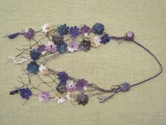 Crochet flowers necklace - neat idea to wear with t-shirts, like a scarf