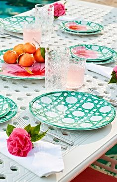 Our exclusive Carleton Varney Caning Dinnerware brings a fresh interpretation of chinoiserie caning to your table. The jade caning motif is updated with a beautiful hibiscus flower on the Appetizer Plates, Small Bowls, Serving Platter and Serving Bowl. Ideal for outdoor entertaining, this chic collection is crafted of shatter-resistant and dishwasher-safe melamine.