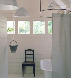 Bathroom Buckets  A great combination - particularly for your outdoor, Mexican, sea-view showers.  Really cute idea!  who would have thought of hanging a bucket from the ceiling to hold your 'stuff' shampoo's etc.