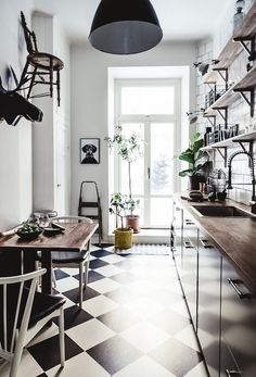 Kitchen in a dramatic Stockholm space in dark colours. 1 Street.