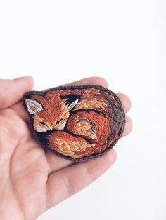 hand-embroidered cotton DMC brooch.